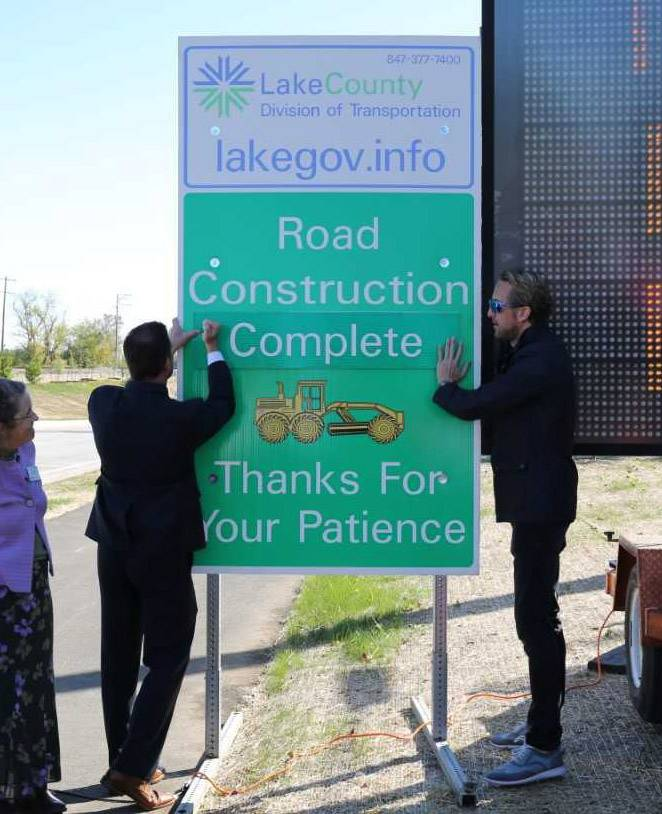 County officials Friday note the ceremonial end of the Washington Street Thoroughfare project.