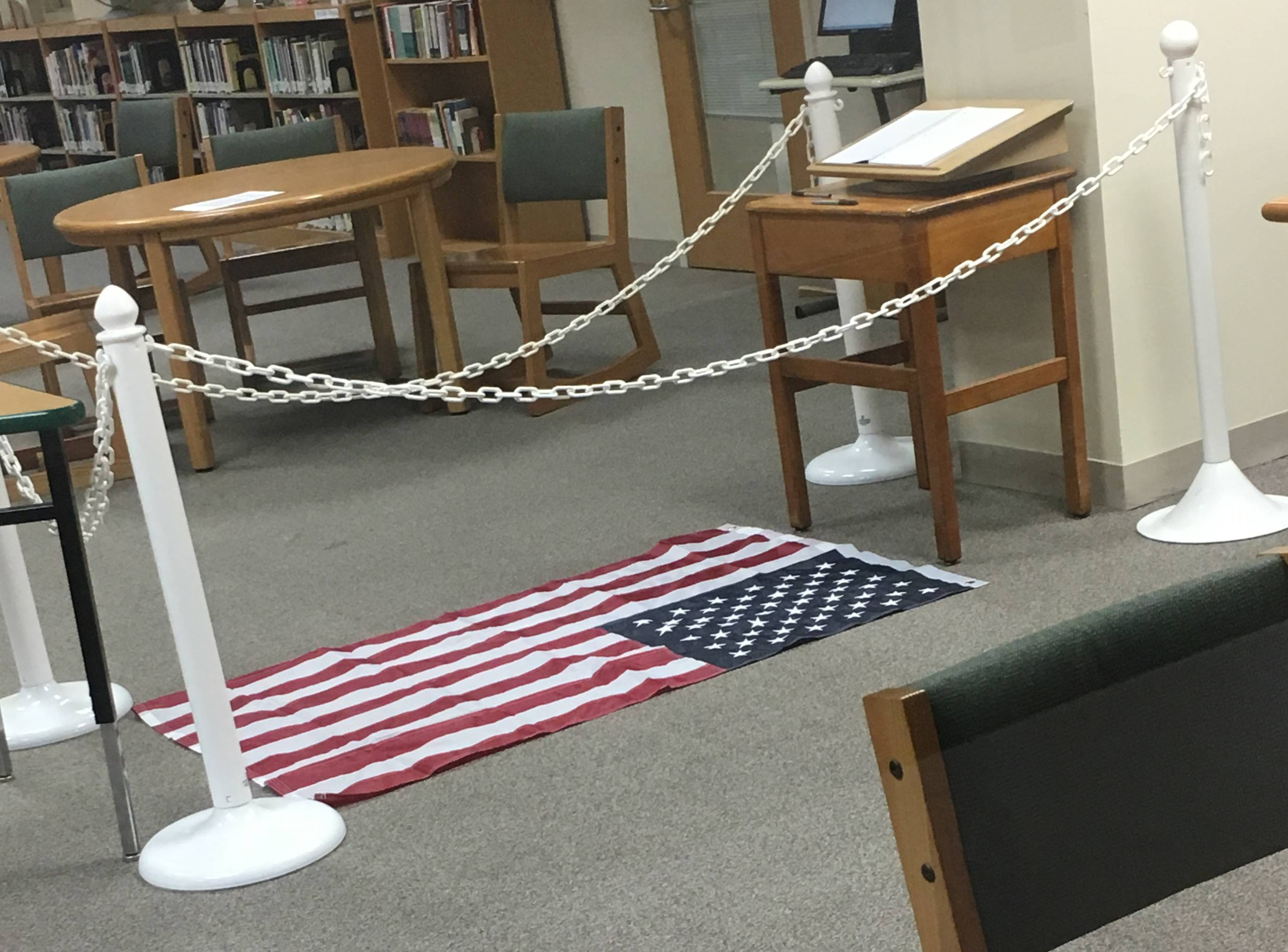 A display at Elmhurst's York High School, which featured a U.S. flag on the library floor, sparked outrage this week on social media. Now some York parents and residents are defending the display.