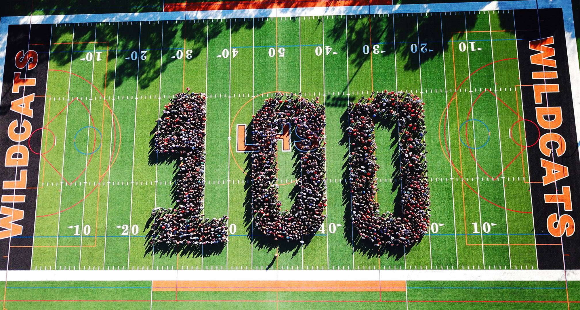 Libertyville High School students, faculty and staff celebrated the centennial on Friday by forming a 100 on the school's football field.