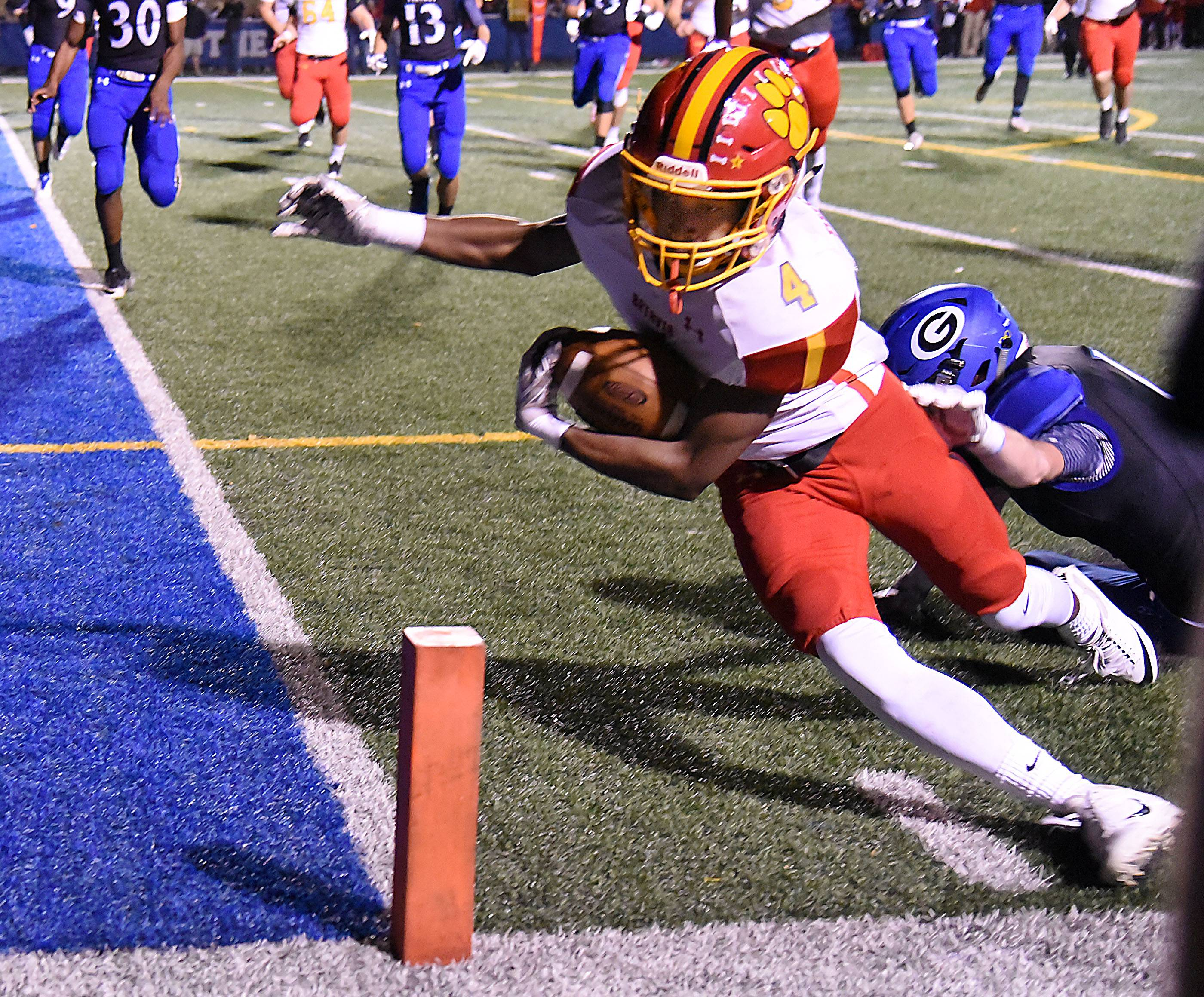 Batavia's Reggie Phillips gets the ball over the goal line before going out of bounds in the first half against Geneva Friday in Geneva.