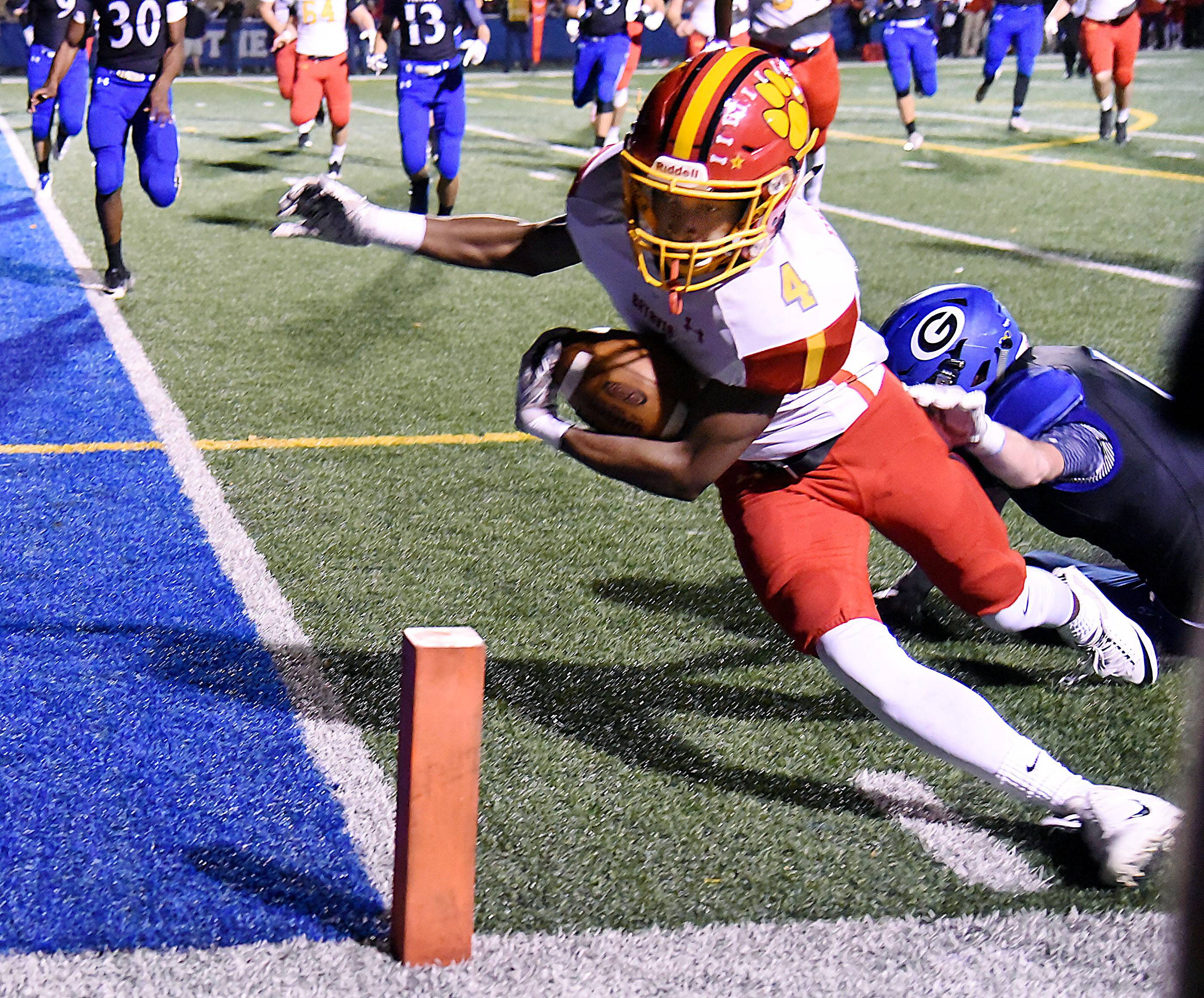 Batavia's Reggie Phillips gets the ball over the goal line before going out-of-bounds in the first half against Geneva Friday in Geneva.