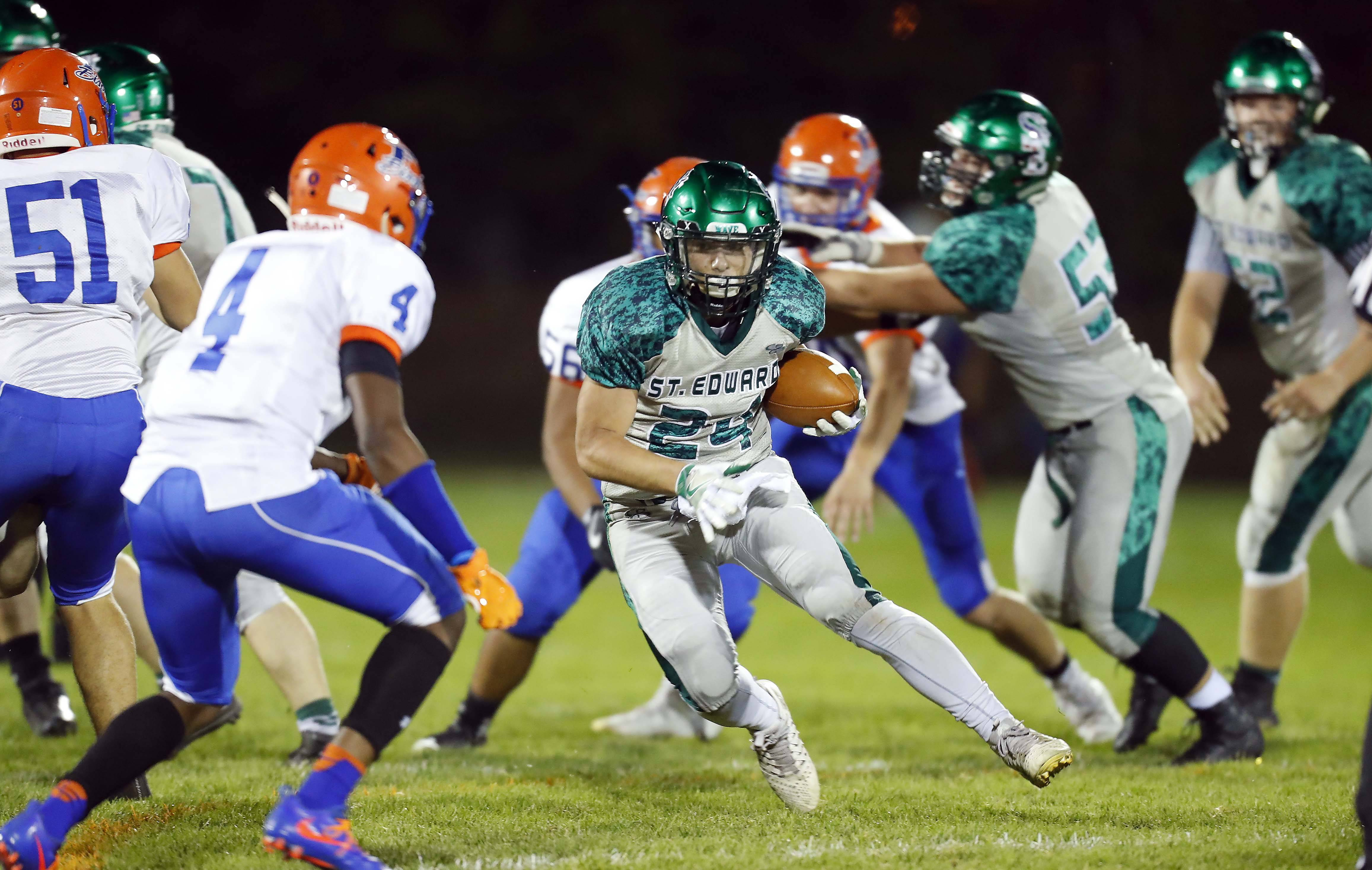 St. Edward's Angel Garcia (24) finds some running room Friday during Fenton at St. Edward football at Greg True Field in Elgin.
