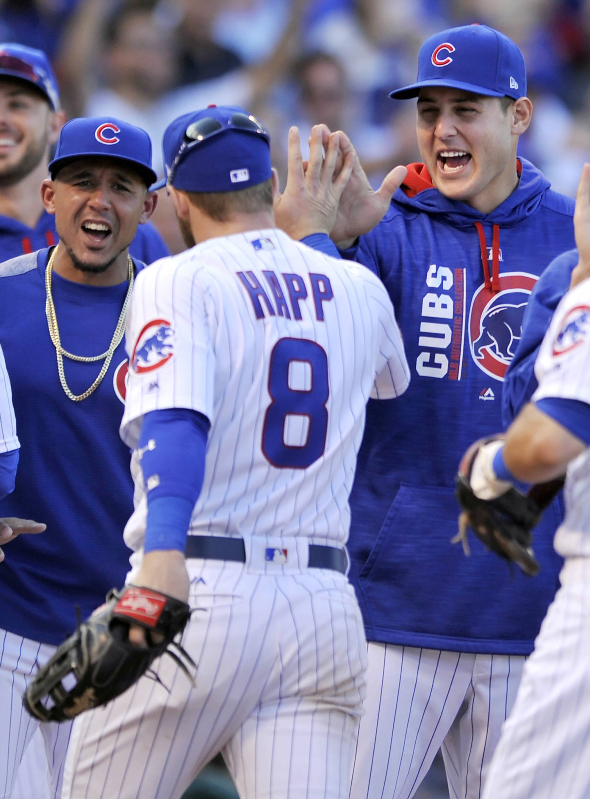 Cubs' first baseman Anthony Rizzo, right, celebrates with teammate Ian Happ after defeating the Cincinnati Reds 5-4 on Friday at Wrigley Field. With many of the regular resting, Happ's 3-run homer in the bottom of the eighth proved the difference maker.