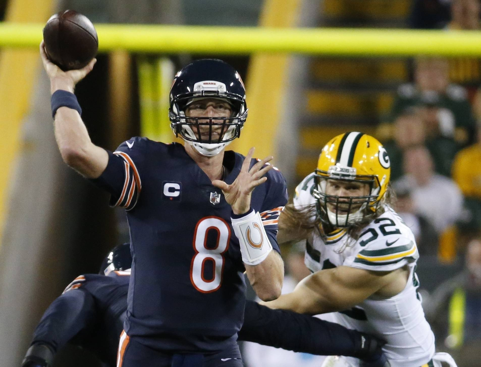 Chicago Bears' Mike Glennon throws in front of Green Bay Packers' Clay Matthews during the second half of an NFL football game Thursday, Sept. 28, 2017, in Green Bay, Wis.