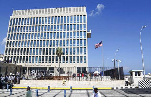 "FILE - In this Aug. 14, 2015, file photo, a U.S. flag flies at the U.S. embassy in Havana, Cuba. Senior U.S. officials say the United States is pulling roughly 60 percent of its staff out of Cuba and warning American travelers not to visit due to ""specific attacks� that have harmed U.S. diplomats. (AP Photo/Desmond Boylan, File)"