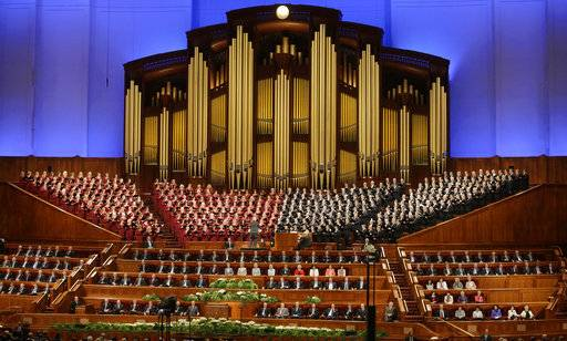 FILE - In this April 1, 2017, file photo, the Mormon Tabernacle Choir of The Church of Jesus Christ of Latter-day Saints perform in the Conference Center at the morning session of the two-day Mormon church conference in Salt Lake City. The Mormon church's twice-a-year conference will take place this weekend amid a tumultuous political climate in the U.S. and without the participation of the religion's 90-year-old president who is dealing with ailing health. (AP Photo/Rick Bowmer, File)
