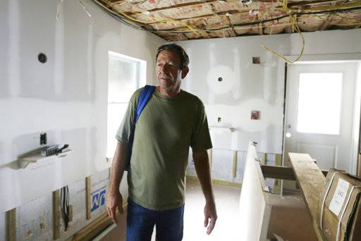 This Sept. 22, 2017 photo shows Gary Ursy in a damaged room at St. Francis House, a homeless shelter in St. Augustine, Fla. Ursy was evacuated from the homeless shelter during Hurricane Irma. When he arrived at a hurricane shelter he was given a yellow wristband and segregated from the rest of the evacuees. Advocated for the homeless say the ill treatment of homeless people during disasters is a national problem that reflects the lack of state and local emergency planning to deal with that population.