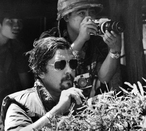 "FILE - In this October 1972 file photo, Richard Pyle, former Saigon Chief of Bureau, foreground, and photographer Nick Ut watch the battle of Xom Suoi, Vietnam, a village on Highway 13 known as ""Thunder Road,"" about 30 miles north of Saigon. Pyle, an Associated Press reporter whose career spanned a half-century of war, catastrophe and other indelible stories has died in New York, Thursday, Sept. 28, 2017. Richard Pyle was 83."