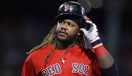 Boston Red Sox designated hitter Hanley Ramirez takes off his batting helmet after grounding out with bases loaded during the sixth inning of a baseball game against the Houston Astros at Fenway Park in Boston, Friday, Sept. 29, 2017. (AP Photo/Charles Krupa)