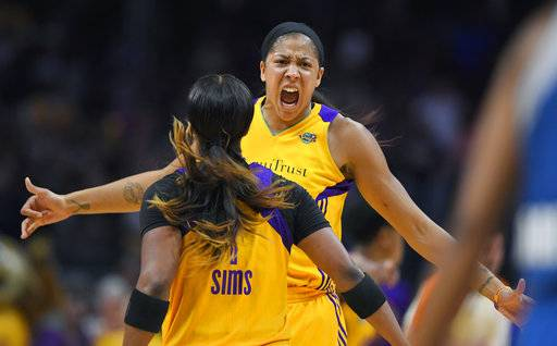 Los Angeles Sparks forward Candace Parker, right, celebrates with guard Odyssey Sims after the Minnesota Lynx turned over the ball during the second half in Game 3 of the WNBA basketball finals Friday, Sept. 29, 2017, in Los Angeles. (AP Photo/Mark J. Terrill)