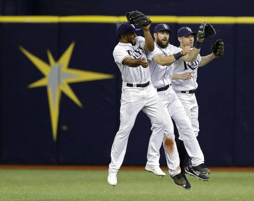 Tampa Bay Rays outfielders, from left, Cesar Puello, Steven Souza Jr. and Peter Bourjos celebrate the team's 7-0 win over the Baltimore Orioles during a baseball game Friday, Sept. 29, 2017, in St. Petersburg, Fla. (AP Photo/Chris O'Meara)
