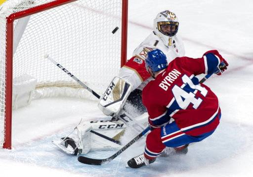 Montreal Canadiens center Paul Byron (41) scores past Florida Panthers goalie Roberto Luongo (1) during the first period of an NHL hockey preseason game Friday, Sept. 29, 2017, in Montreal. (Paul Chiasson/The Canadian Press via AP)