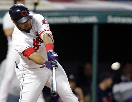Cleveland Indians' Edwin Encarnacion hits a three-run double off Chicago White Sox starting pitcher David Holmberg in the third inning of a baseball game, Friday, Sept. 29, 2017, in Cleveland. Yandy Diaz, Austin Jackson and Jose Ramirez scored on the play. (AP Photo/Tony Dejak)