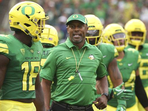 FILE - In this Sept. 2, 2017, file photo, Oregon coach Willie Taggart, center, joins his team as they take the field for an NCAA college football game against Southern Utah in Eugene, Ore. Oregon faces California at home on Saturday, Sept. 30, 2017. (AP Photo/Chris Pietsch, File)