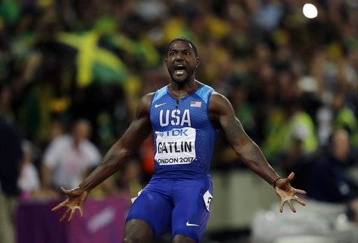 "FILE - In this Aug. 5, 2017 file photo, United States' Justin Gatlin celebrates after crossing the line to win the gold medal in the men's 100m final during the World Athletics Championships in London. World sprint champion Gatlin says he won't be taking the knee in protest this weekend at an exhibition race in Brazil. Asked about it before Sunday's race, Gatlin says, ""I'm going to stand up. I mean, I'm going to stand up. I'm not saying if I take the knee or stand, I'm not for the protests."" (AP Photo/Tim Ireland, File)"