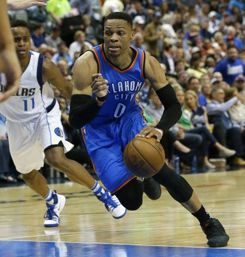 "File-This photo taken March 27, 2017, shows Oklahoma City Thunder guard Russell Westbrook (0) dribbling during the first half of an NBA basketball game against the Dallas Mavericks in Dallas. Westbrook has yet to sign an extension, but the reigning league MVP said Oklahoma City is where he wants to be and he is ""happy� about the offseason additions of superstars Carmelo Anthony and Paul George. ""I love it here,� he said. ""I like where I'm at, and I like where our team is at.�(AP Photo/LM Otero, File)"