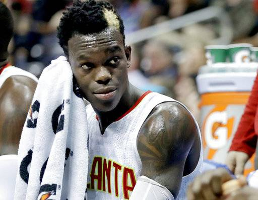 FILE - In this March 8, 2017, Atlanta Hawks' Dennis Schroder, of Germany, sits on the bench during the second quarter of an NBA basketball game against the Brooklyn Nets in Atlanta. Schroder has been charged with battery after a fight at a late-night restaurant. Brookhaven police reported that Schroder and three other men were arrested in an altercation around 2 a.m. Friday, Sept. 29, 2017. at the 6am restaurant. (AP Photo/David Goldman, File)