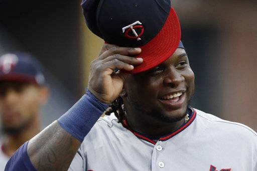 FILE - In this Aug. 1, 2017, file photo, Minnesota Twins' Miguel Sano smiles before a baseball game against the San Diego Padres in San Diego. Sano is coming back just in time for the playoffs. The Twins activated their All-Star third baseman on Friday, Sept. 29, in time for the season's final series against Detroit. Sano has missed 38 games with a stress reaction after fouling a ball off his left shin, and had been on the 10-day disabled list. (AP Photo/Gregory Bull, File)
