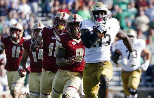 FILE - In this Saturday, Sept. 16, 2017, file photo, Notre Dame's Josh Adams (33) breaks away from Boston College defenders during the first half of an NCAA college football game in Boston. The Irish are ranked No. 7 in the country in rushing at 293.5 yards per game and third nationally with 6.83 yards per carry. The offensive line has paved the way ever since a Sept. 9 loss to Georgia. Notre Dame hosts Miami of Ohio on Saturday. (AP Photo/Michael Dwyer)