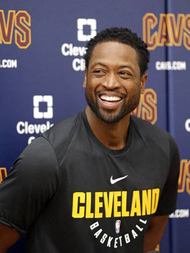 Cleveland Cavaliers' Dwyane Wade smiles as he answers questions during a news conference at the NBA basketball team's training facility, Friday, Sept. 29, 2017, in Independence, Ohio. Wade once convinced LeBron James that Miami was the place to be. Seven years later, James lured Wade to Ohio for the chance to win another NBA title, together. (AP Photo/Tony Dejak)