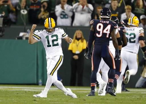 Green Bay Packers' Aaron Rodgers celebrates a touchdown pass during the first half of an NFL football game against the Chicago Bears Thursday, Sept. 28, 2017, in Green Bay, Wis.