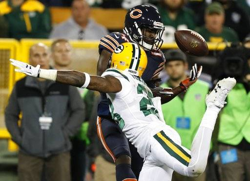 Green Bay Packers' Josh Hawkins breaks up a pass intended for Chicago Bears' Deonte Thompson during the second half of an NFL football game Thursday, Sept. 28, 2017, in Green Bay, Wis.