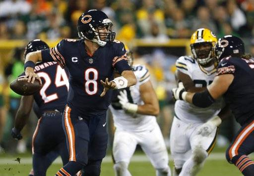Chicago Bears' Mike Glennon scrambles during the second half of an NFL football game against the Green Bay Packers Thursday, Sept. 28, 2017, in Green Bay, Wis.