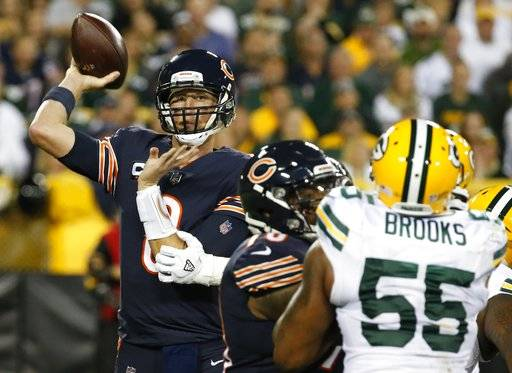 Green Bay Packers' Justin Vogel throws during the first half of an NFL football game against the Green Bay Packers Thursday, Sept. 28, 2017, in Green Bay, Wis.