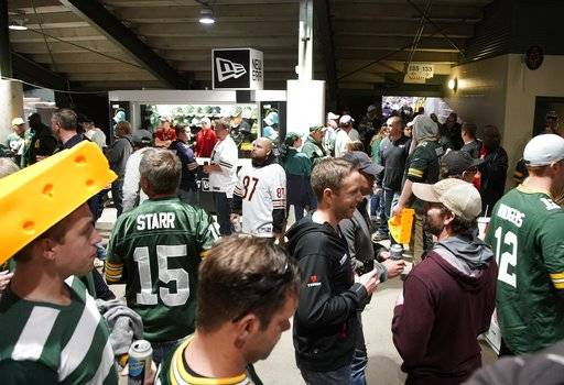 Fans fill the concourse at Lambeau Field during a lightning delay in NFL football game between the Green Bay Packers and the Chicago Bears Thursday, Sept. 28, 2017, in Green Bay, Wis.