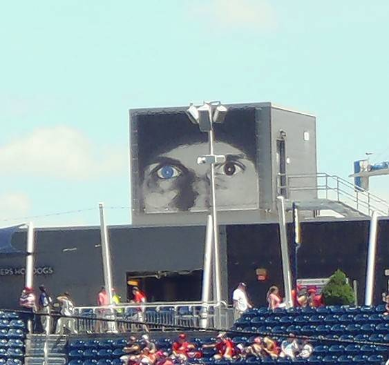 From a building across the street, a mural of Max Scherzer, and his different-colored eyes (really), peers into Nationals Park.