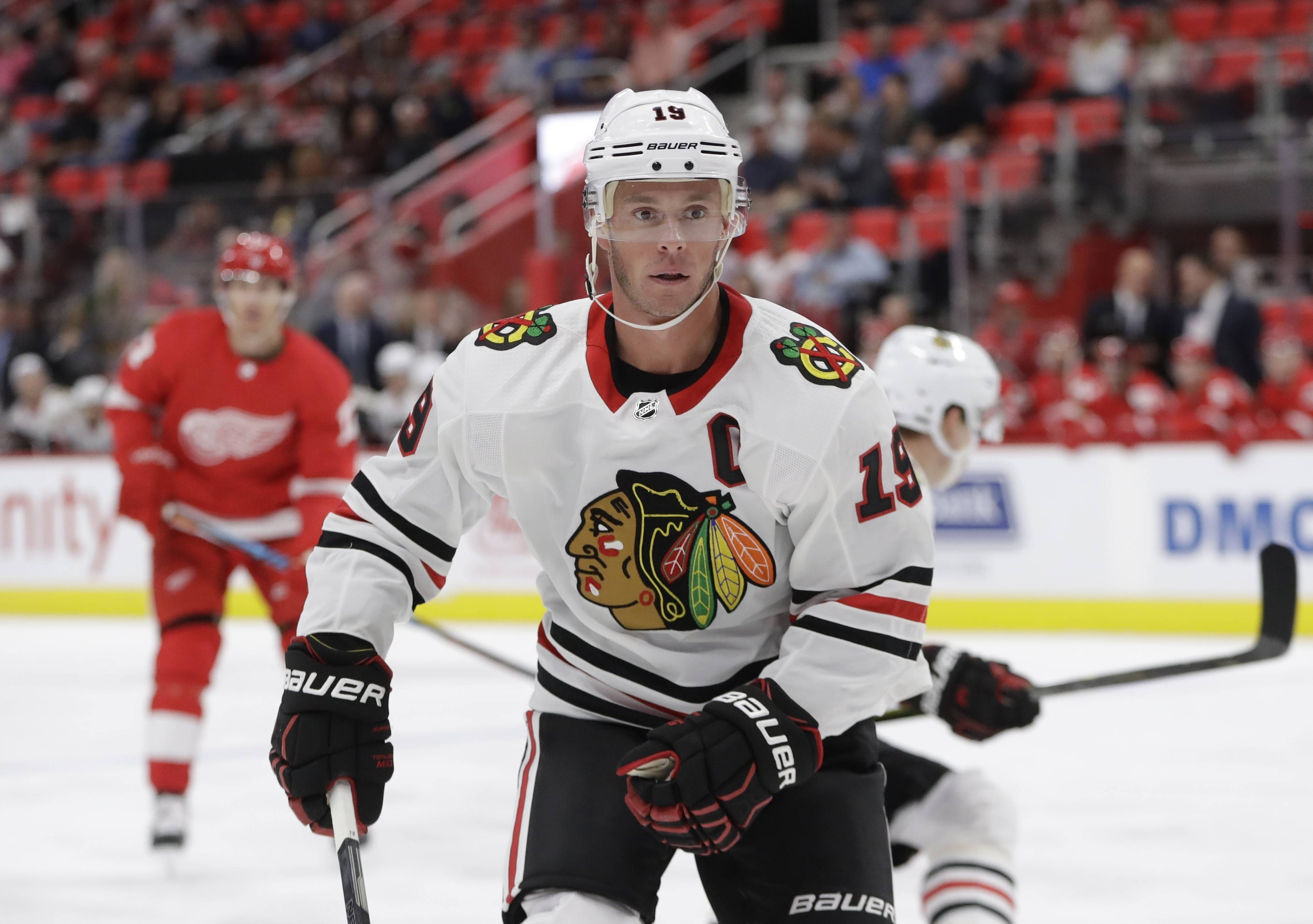 Chicago Blackhawks center Jonathan Toews chases the puck during the first period of an NHL hockey game against the Detroit Red Wings, Thursday, Sept. 28,2017, in Detroit.