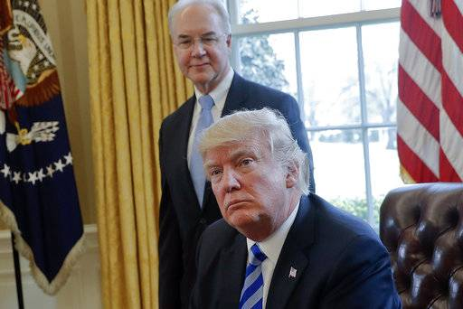 FILE - In this March 24, 2017 file photo, President Donald Trump with Health and Human Services Secretary Tom Price are seen in the Oval Office of the White House in Washington. Price resigned Sept. 29, after his costly travel triggered investigations that overshadowed the administration's agenda and angered his boss. Price's regrets and partial repayment couldn't save his job.