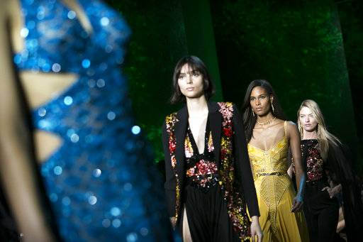 Models, including Cindy Bruna, second from right, and Martha Hunt, right, wear creations for Elie Saab's Spring-Summer 2018 ready-to-wear fashion collection presented Saturday, Sept. 30, 2017 in Paris.