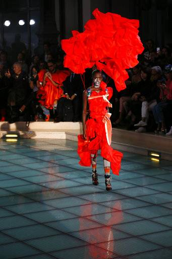 A model wears a creation for Vivienne Westwood Spring/Summer 2018 ready-to-wear fashion collection presented in Paris,Saturday, Sept. 30, 2017.