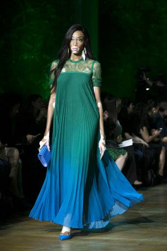 Model Winnie Harlow wears a creation for Elie Saab's Spring-Summer 2018 ready-to-wear fashion collection presented Saturday, Sept. 30, 2017 in Paris.