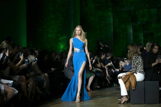 Model Candice Swanepoel wears a creation for Elie Saab's Spring-Summer 2018 ready-to-wear fashion collection presented Saturday, Sept. 30, 2017 in Paris.