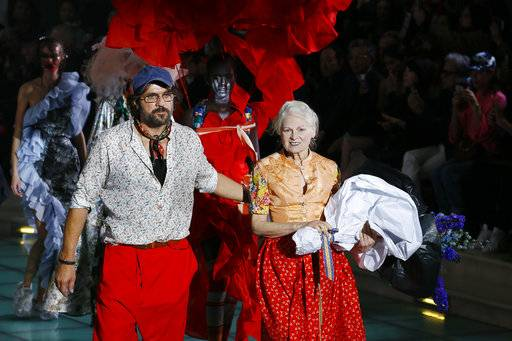 Designer Vivienne Westwood, right, is joined by Andreas Kronthaler at the end of the Vivienne Westwood Spring/Summer 2018 ready-to-wear fashion collection presented in Paris,Saturday, Sept. 30, 2017.