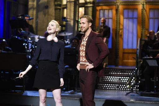 "In this image released by NBC, Emma Stone, left, appears with host Ryan Gosling during the opening monologue for ""Saturday Night Live,"" in New York on  Sept. 30, 2017.  (Will Heath/NBC via AP)"