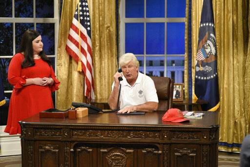 "In this image released by NBC, Aidy Bryant portrays White House press secretary Sarah Huckabee Sanders, left, and Alec Baldwin portrays President Donald Trump during the cold open for ""Saturday Night Live,"" on Sept. 30, 2017, in New York. (Will Heath/NBC via AP)"