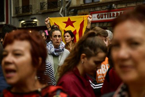 A pro independence supporter holds up ''esteleda'' or Catalan pro independence flags, in support of the Catalonia's secession referendum, in Pamplona, northern Spain, Sunday, Oct.1, 2017.   Catalonia's regional government is holding a referendum Sunday on the possibility of breaking away from Spain, despite Spain's Constitutional Court ordering the vote to be suspended and prompting a police crackdown.