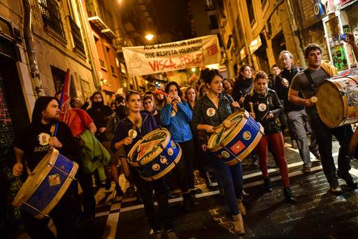 Pro independence supporters play their drums with banner reading, ''Long life working class'', while they walk through the old city in support of the Catalonia's secession referendum, in Pamplona, northern Spain, Sunday, Oct. 1, 2017.   Catalonia's defiant regional government is pressing ahead with a ballot on seceding from Spain.