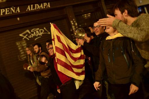 Pro independence supporter holds up ''esteleda'' or Catalan pro independence flag while walks along the old city in support of the Catalonia's secession referendum, in Pamplona, northern Spain, Sunday, Oct.1, 2017.  Catalonia's defiant regional government is pressing ahead with a ballot on seceding from Spain.