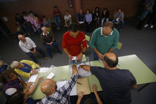 Votes are counted at a school assigned to be a referendum polling station by the Catalan government in Girona, Spain, Sunday evening, Oct. 1, 2017. During the day Spanish riot police smashed their way into polling stations to try to halt a disputed independence referendum and fired rubber bullets at protesters.
