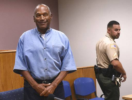 FILE - In this July 20, 2017, file photo, former NFL football star O.J. Simpson enters for his parole hearing at the Lovelock Correctional Center in Lovelock, Nev. A Nevada prisons official says a plan is in place for Simpson to be released to parole as early as Monday, Oct. 2, 2017, from a facility in the Las Vegas area. Nevada Department of Corrections spokeswoman Brooke Keast said Wednesday, Sept. 27 that the process and documents still must be finalized for Simpson's release after nine years behind bars for an armed robbery conviction. (Jason Bean/The Reno Gazette-Journal via AP, Pool, File)
