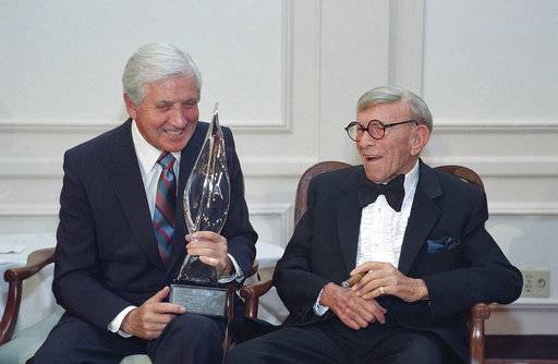 "FILE - In this March 14, 1993, file photo, Monty Hall, left, recipient of the 2nd Annual George Burns Lifetime Award, laughs with George Burns at the United Jewish Fund tribute to humanitarian Hall, in the Century City section of Los Angeles. Former ""Let's Make a Deal"" host Hall has died after a long illness at age 96. His daughter Sharon Hall says he died Saturday, Sept. 30, 2017, at his home in Beverly Hills, Calif."