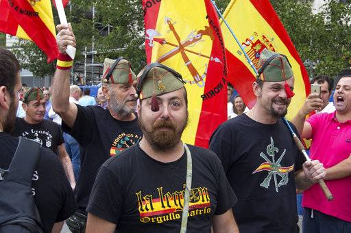 Protesters in legionnaires uniforms participate as thousands packed the central Cibeles square in Madrid, Spain, Saturday, Sept. 30, 2017. Thousands of pro-Spanish unity supporters donning Spanish flags have rallied in a central Madrid plaza to protest the Catalan regional government's drive to separate from Spain. Message on t-shirt reads: 'The Legion, Patriotic Pride'.