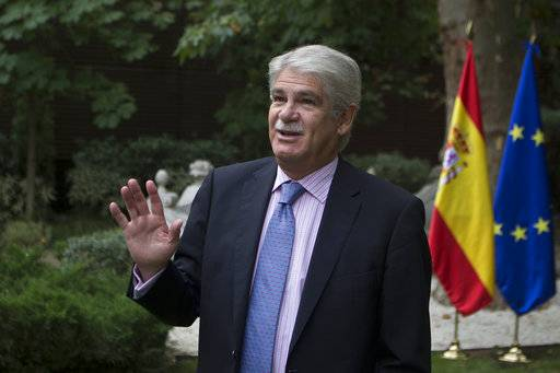 "Spain's Foreign Minister Alfonso Dastis talks before an interview with The Associated Press about the Catalonia's referendum at the Foreign Ministry in Madrid, Spain, Saturday, Sept. 30, 2017. Dastis said Saturday the Catalan government's plan is anti-democratic and runs ""counter to the goals and ideals"" of the European Union."