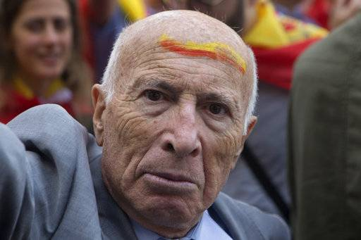 A man with the colors of the Spanish flag painted on his forehead protests as thousands packed the central Cibeles square in Madrid, Spain, Saturday, Sept. 30, 2017. Thousands of pro-Spanish unity supporters donning Spanish flags have rallied in a central Madrid plaza to protest the Catalan regional government's drive to separate from Spain.