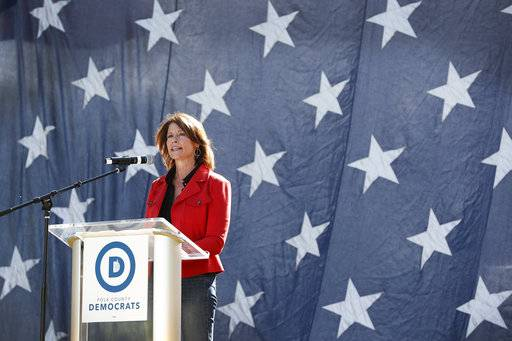 U.S. Rep. Cheri Bustos, D-Ill., speaks during the Polk County Democrats Steak Fry, Saturday, Sept. 30, 2017, in Des Moines, Iowa.