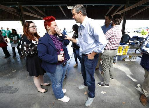 U.S. Rep. Tim Ryan, D-Ohio, talks with Heather Ryan, left, during the Polk County Democrats Steak Fry, Saturday, Sept. 30, 2017, in Des Moines, Iowa.